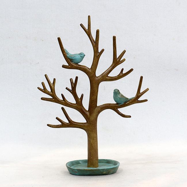파랑새와 나무 조각상